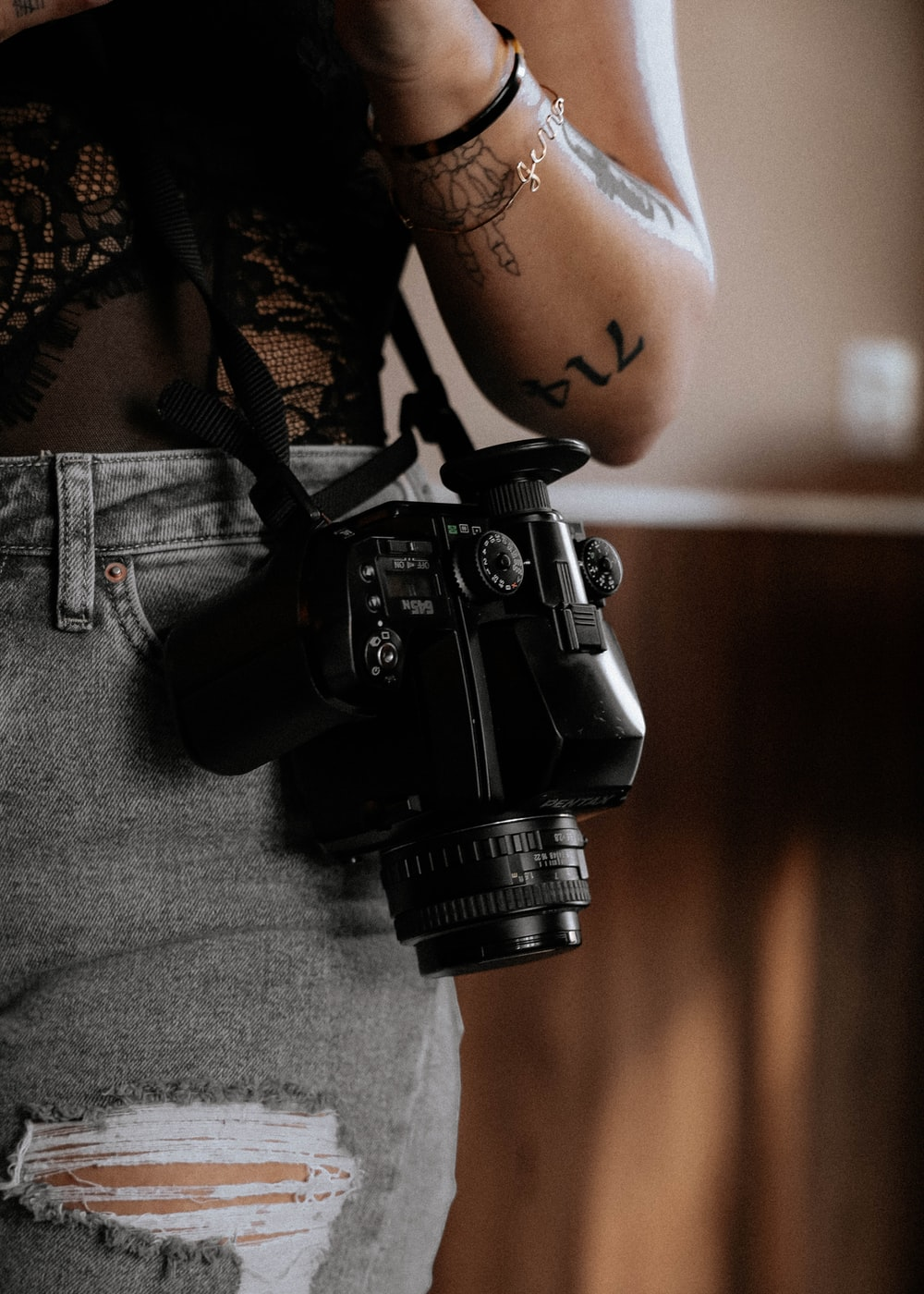 black dslr camera on persons lap