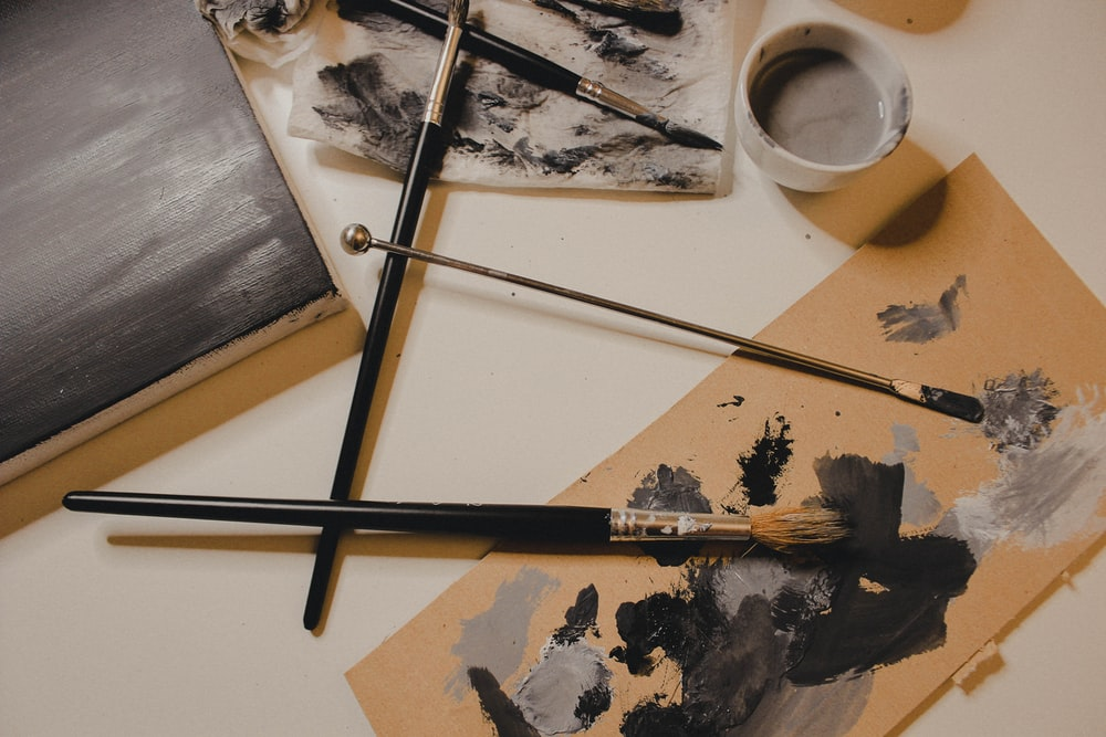 black and white painting on white wooden table
