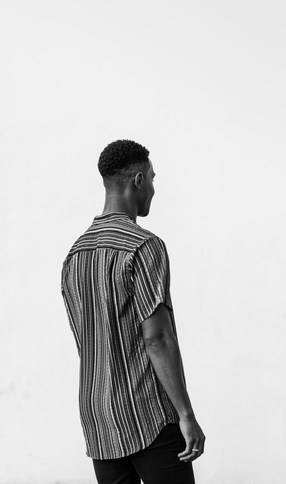 man in black and white stripe shirt