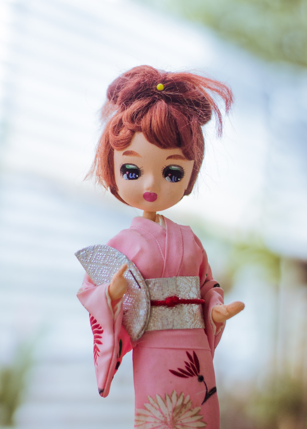 red haired girl in pink dress doll