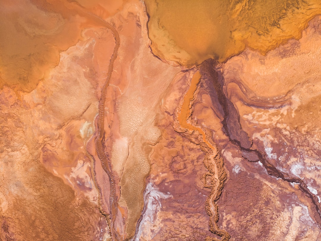 An aerial view of the vibrant and colorful waters surrounding the RioTinto mines in Huelva