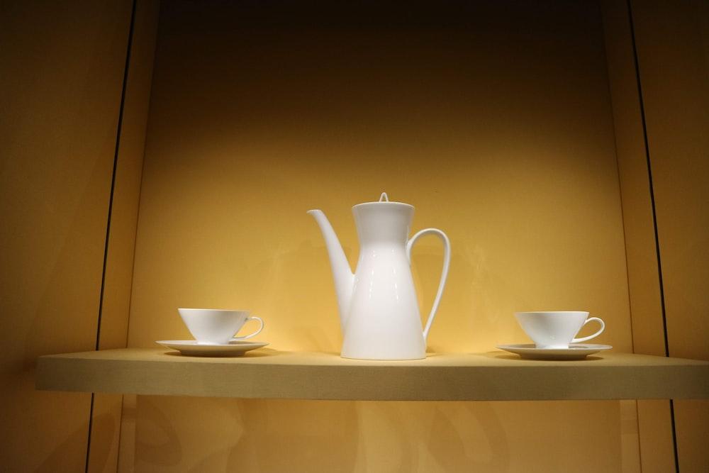 white ceramic pitcher on white wooden shelf