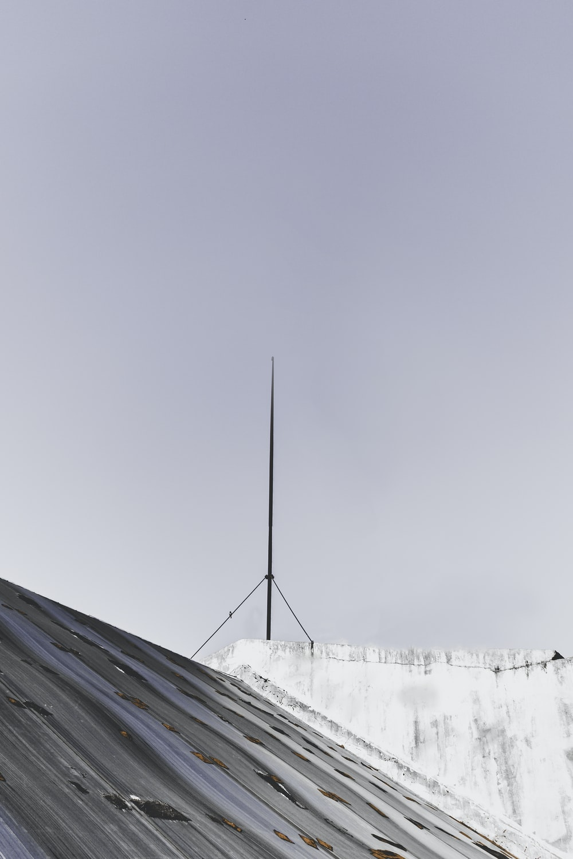 black metal roof under white sky during daytime