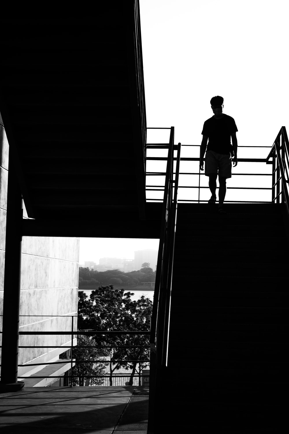 man in black jacket standing on stairs