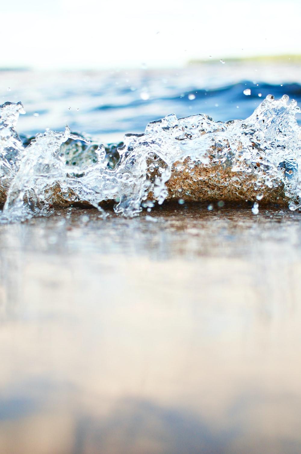 water splash on brown rock