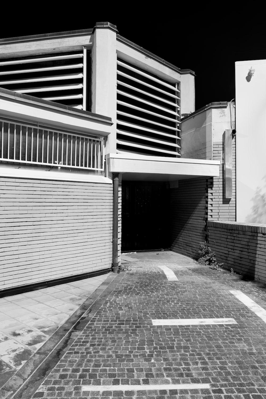 grayscale photo of empty street