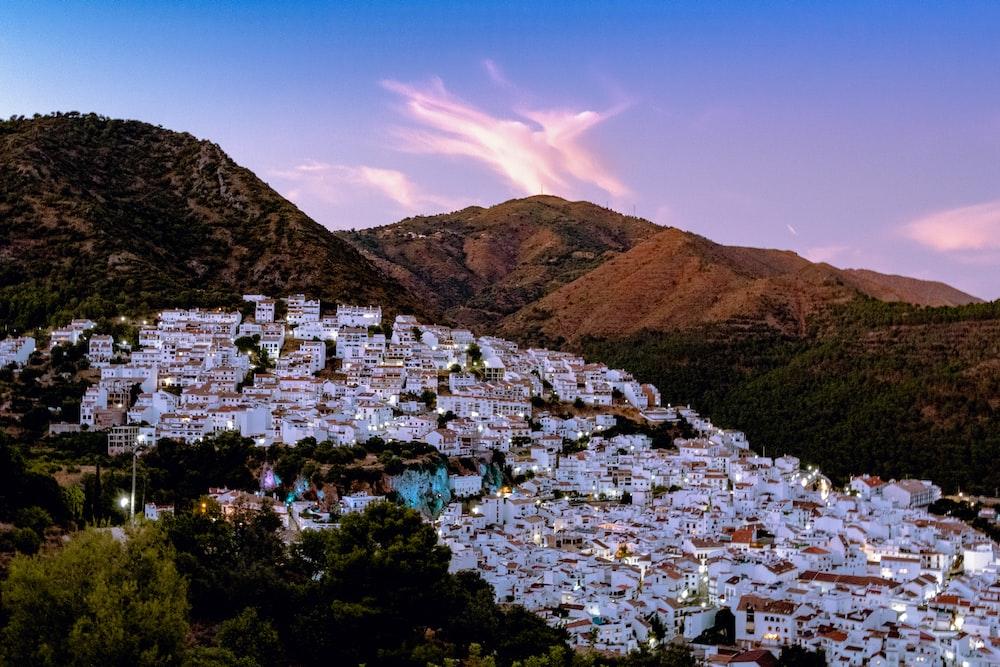 white houses near mountain under blue sky during daytime