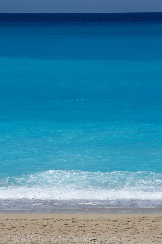 blue sea water during daytime