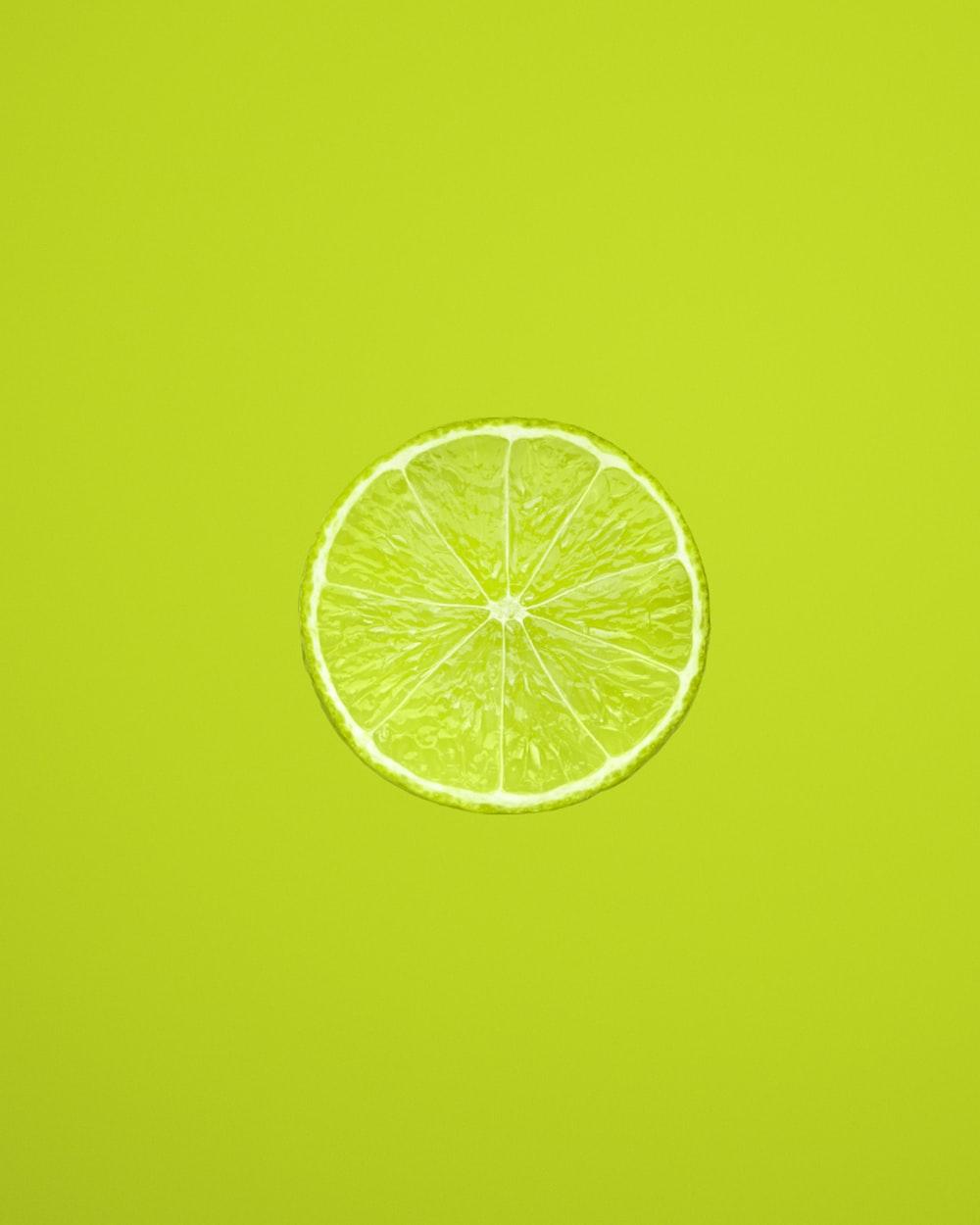 yellow lemon fruit on green background