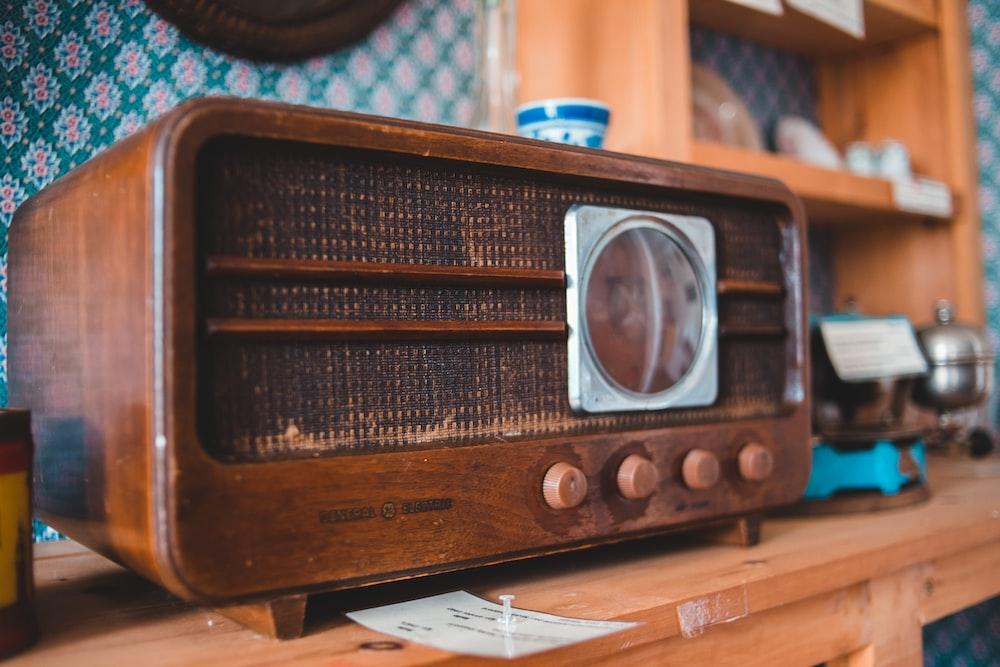 brown and silver vintage radio