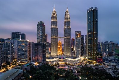 high rise building during night time malaysia zoom background