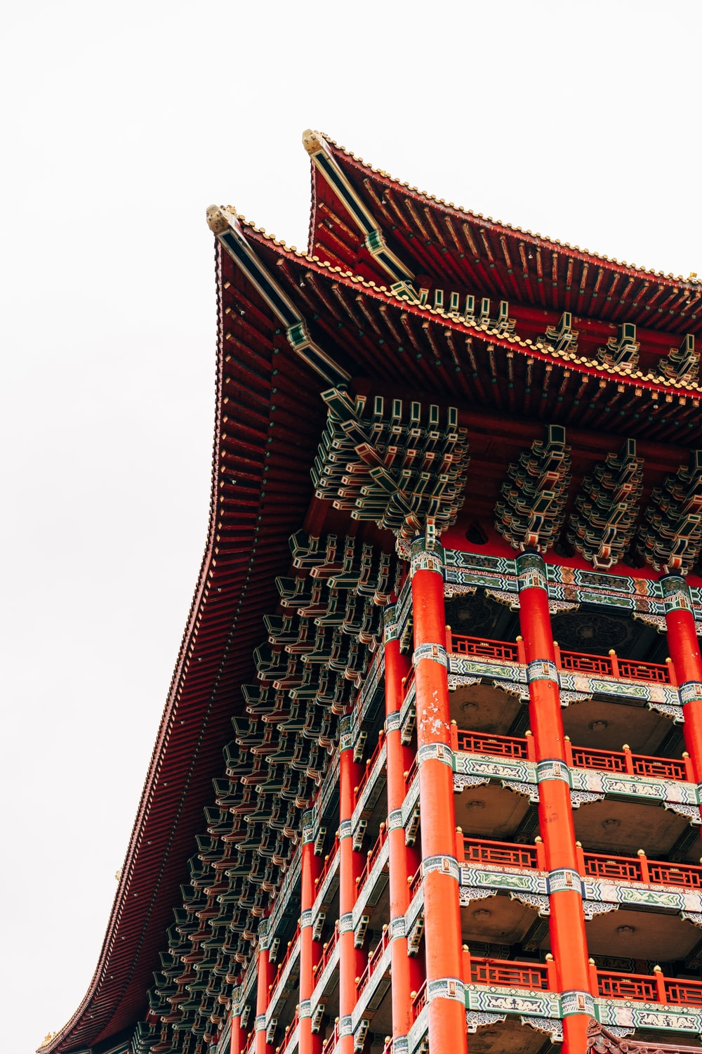 red and white temple under white sky during daytime