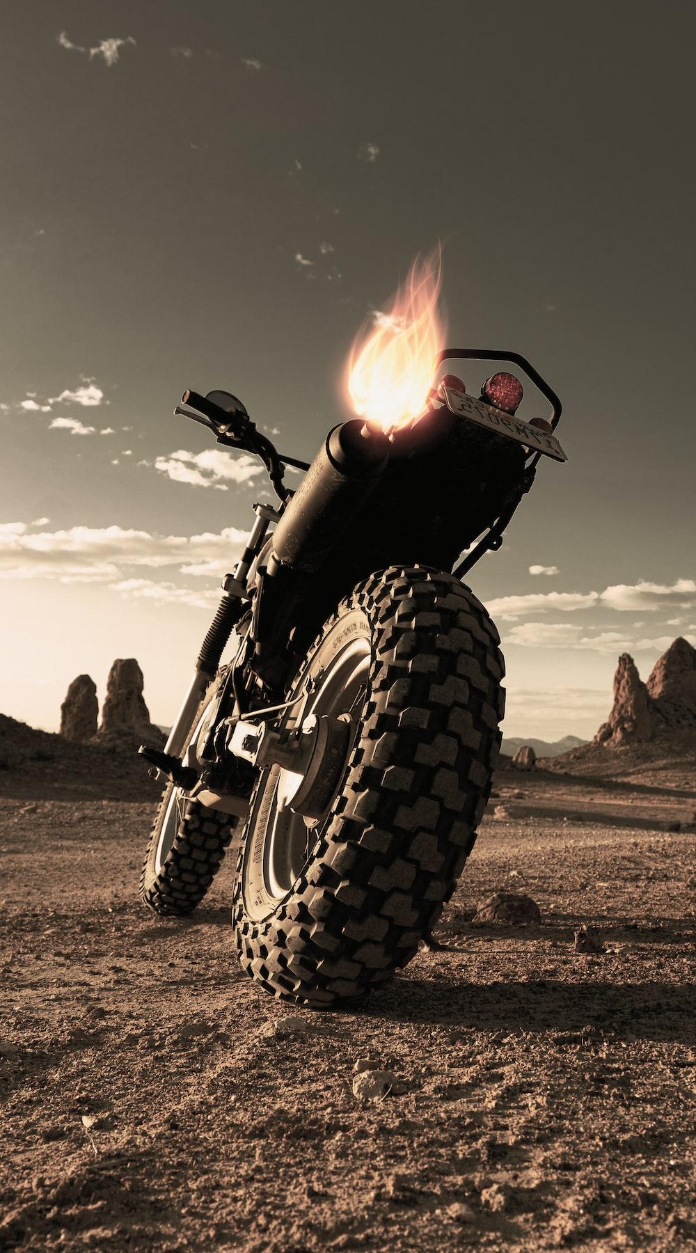 black motorcycle on brown field during daytime