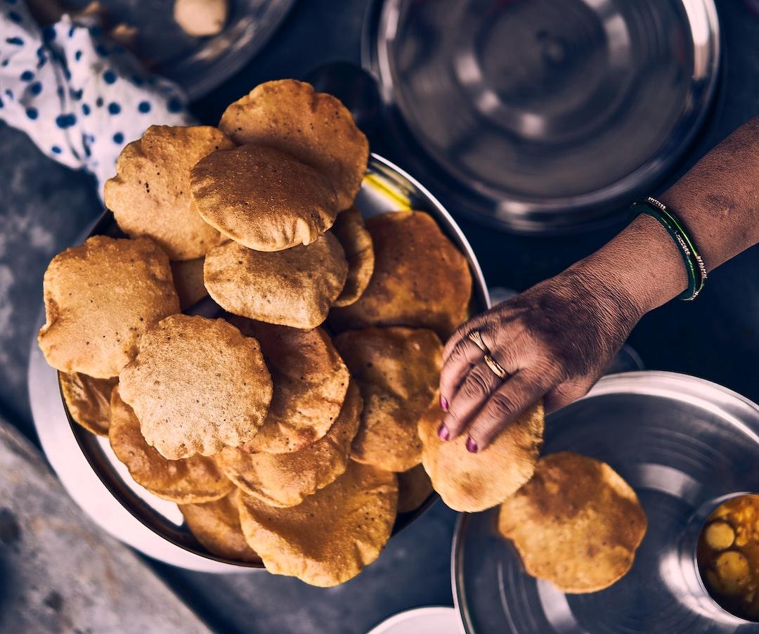 A woman serving Pooris