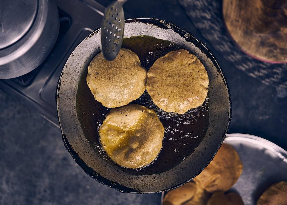 brown and black food on black pan