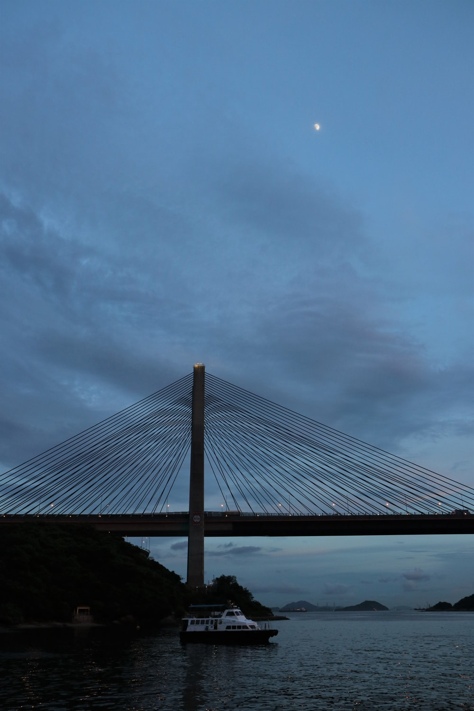 brown bridge under cloudy sky during daytime