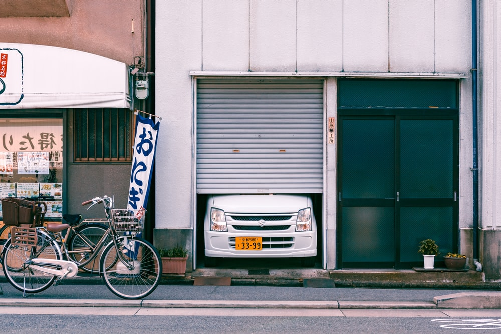 silver honda car parked beside blue and white wall