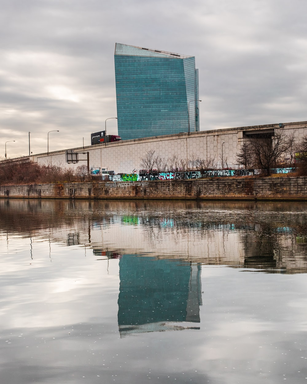 gray building near body of water during daytime