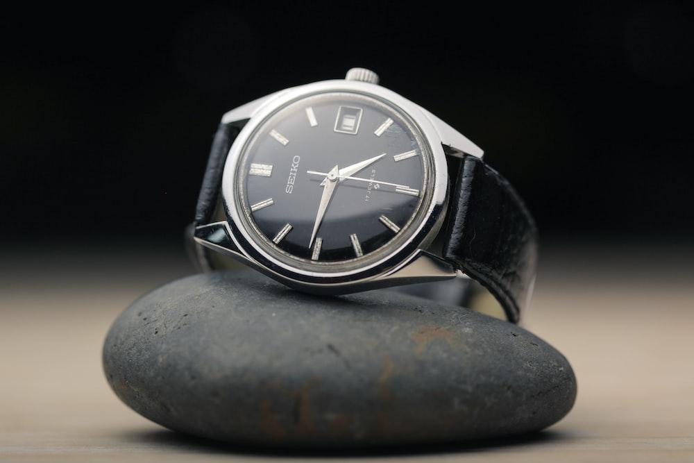black round analog watch at 10 10