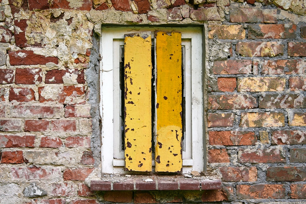 yellow and white wooden window