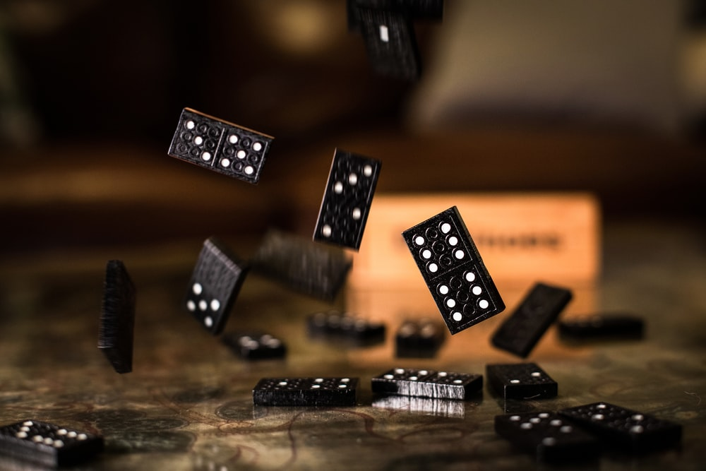 black and white dices on brown wooden table