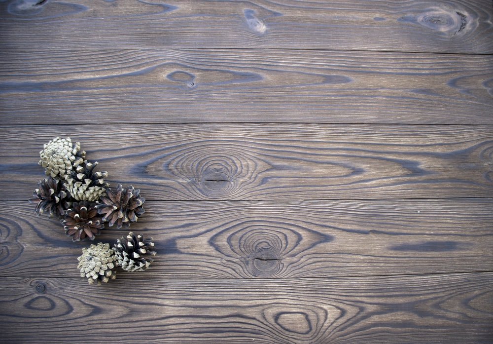 silver and gold flower ornament on brown wooden table