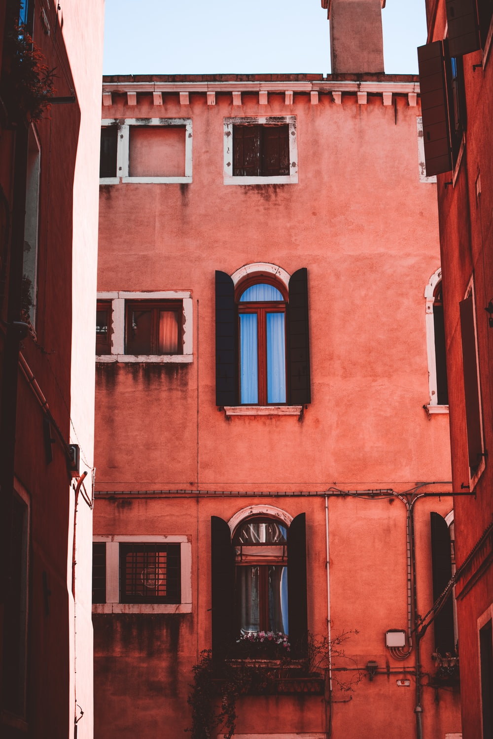 red concrete building during daytime