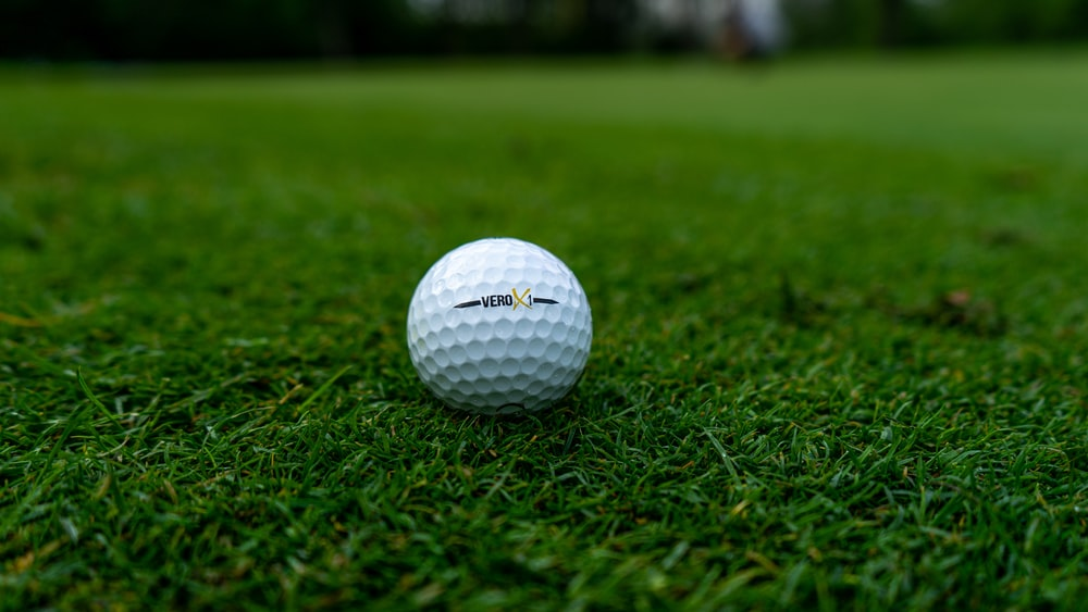 white golf ball on green grass field during daytime