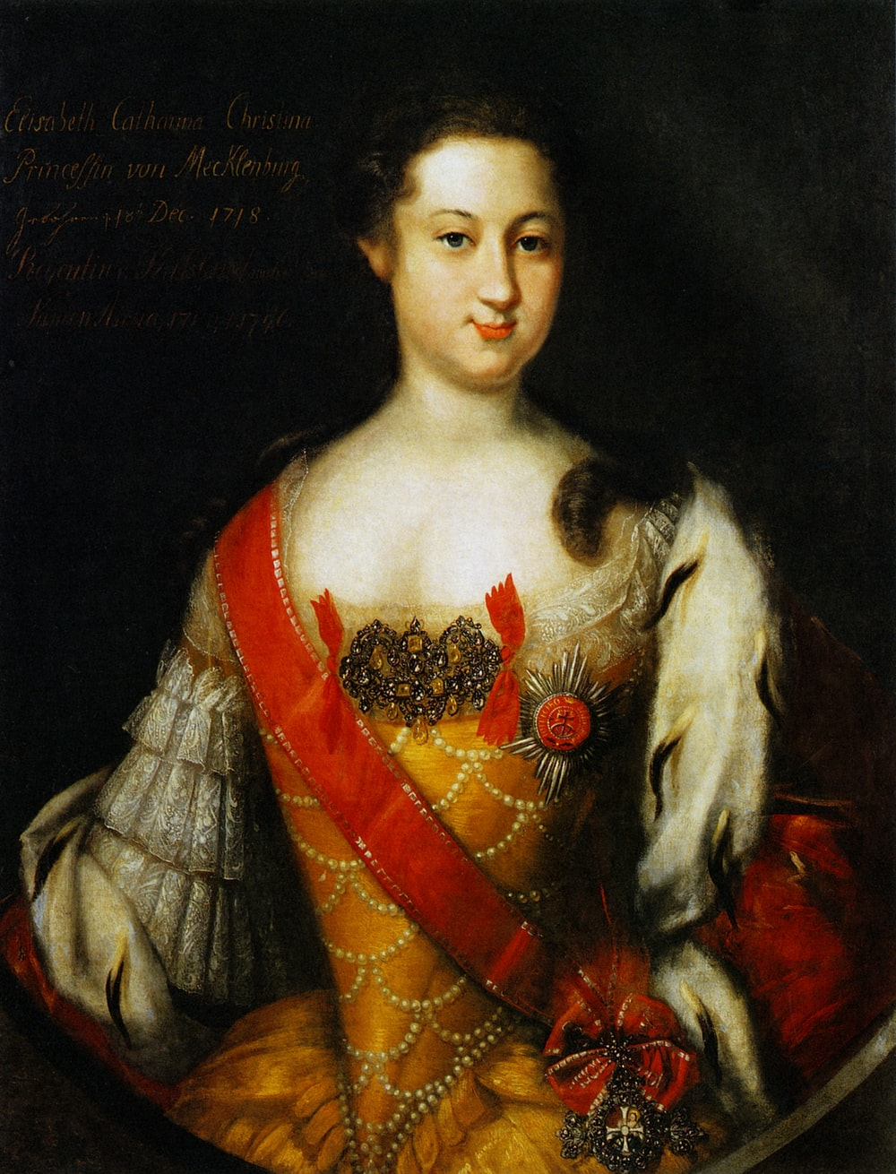 woman in red and gold dress painting