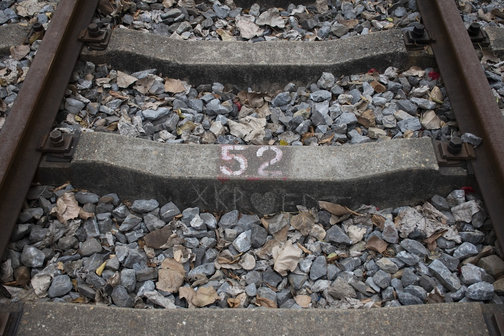 red and white arrow sign on gray concrete stairs