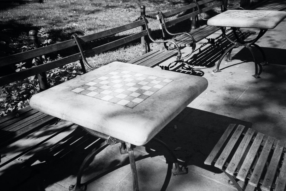 grayscale photo of wooden table