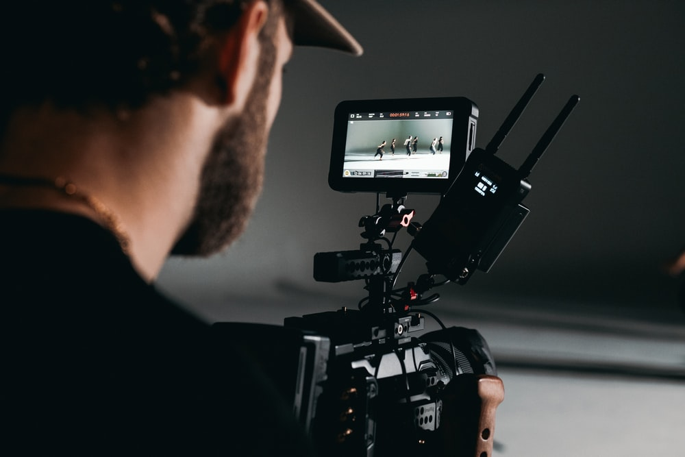 man in black shirt holding video camera