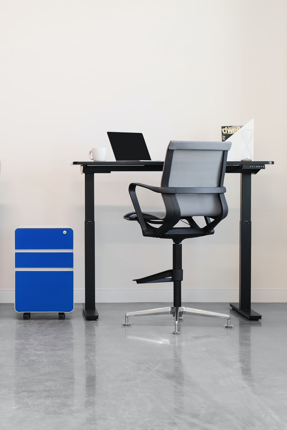 black and silver laptop computer on black office rolling chair