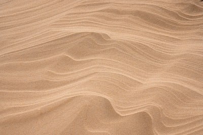 brown sand with shadow of person brown zoom background