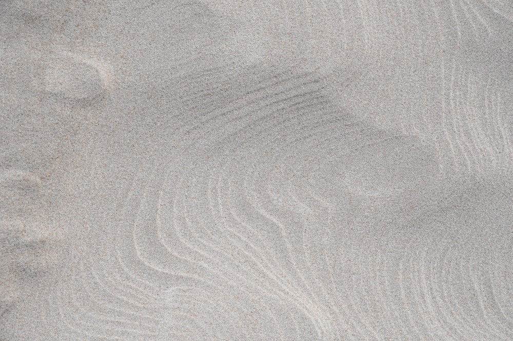 close up photo of gray sand