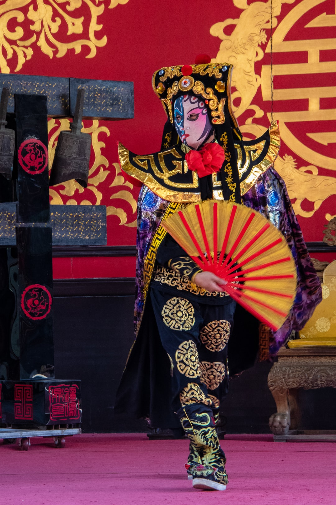 A Chinese Mask Actor, entertaining tourists at the Summer Palace, Beijing, China.