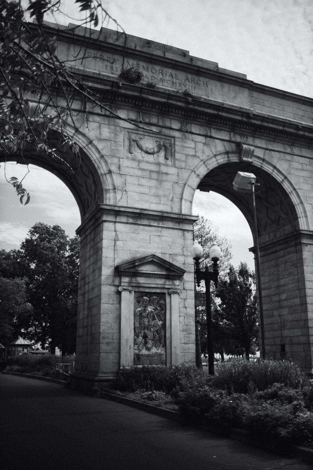grayscale photo of arch shaped arch gate