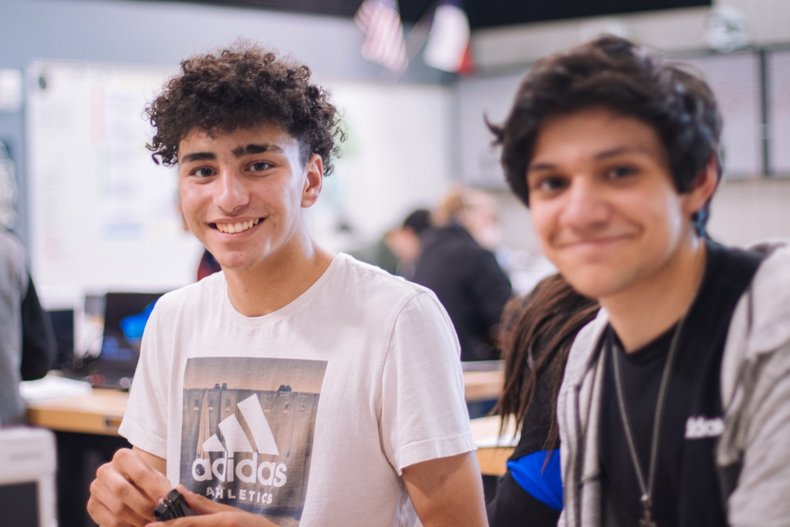 Two teenage boys smiling