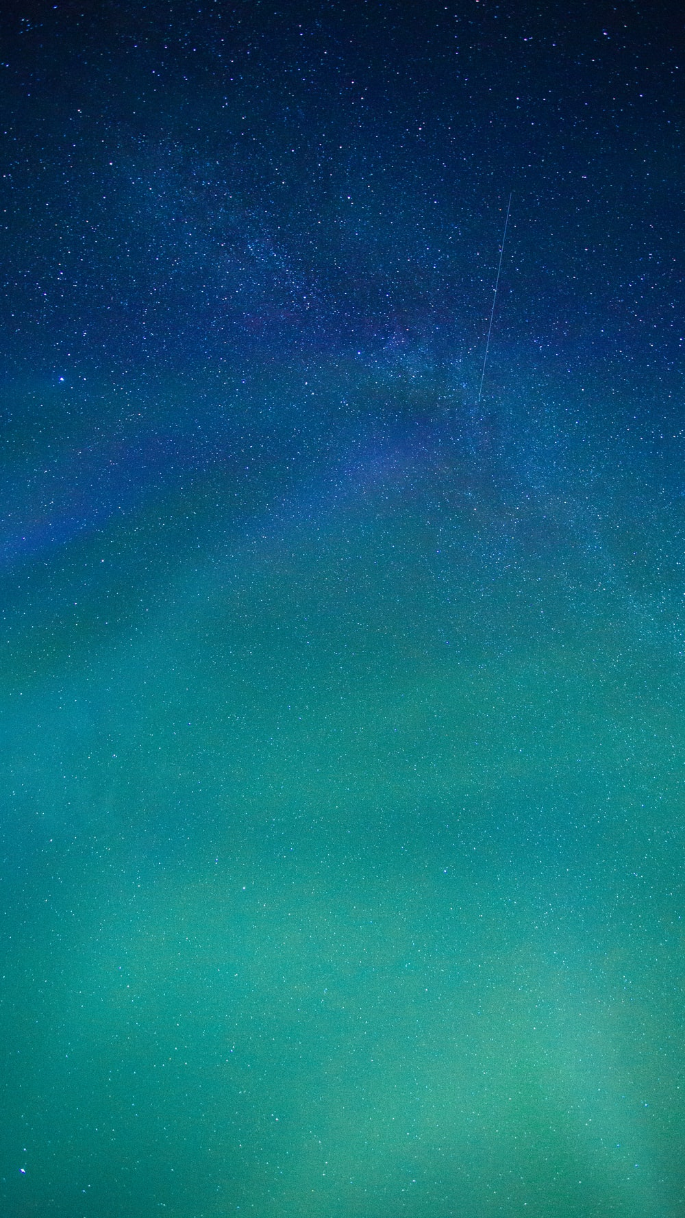 blue and black sky with stars