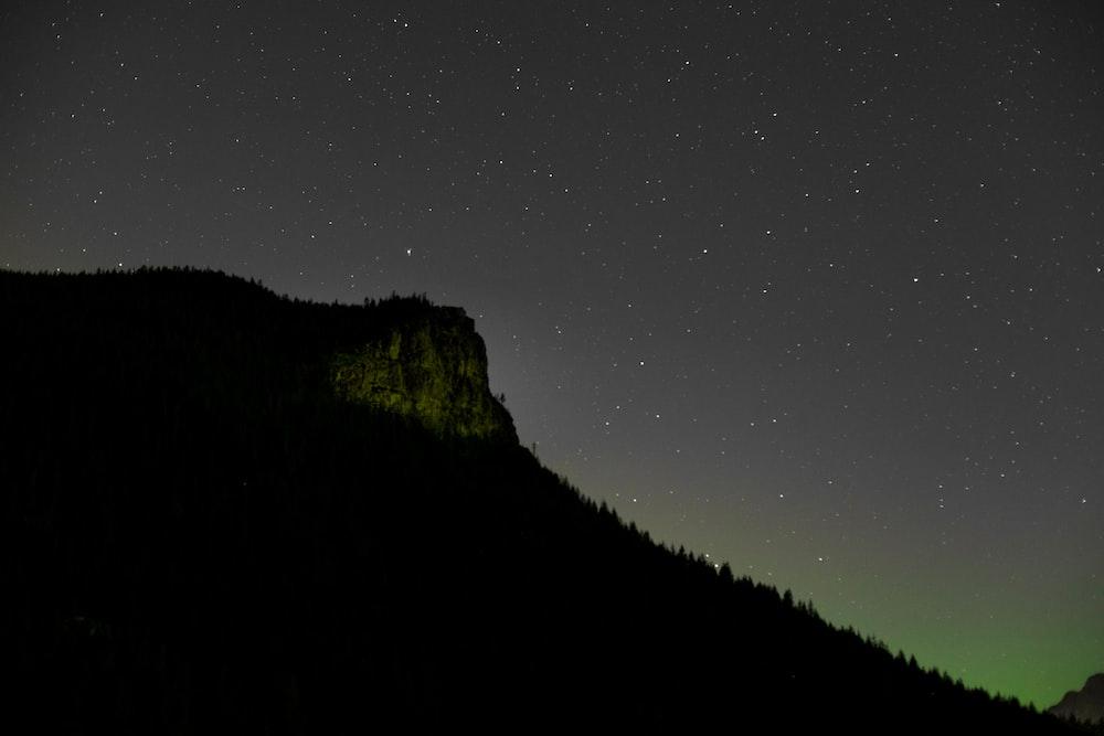 green mountain under starry night