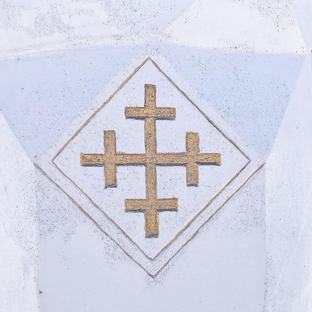 blue cross on white textile