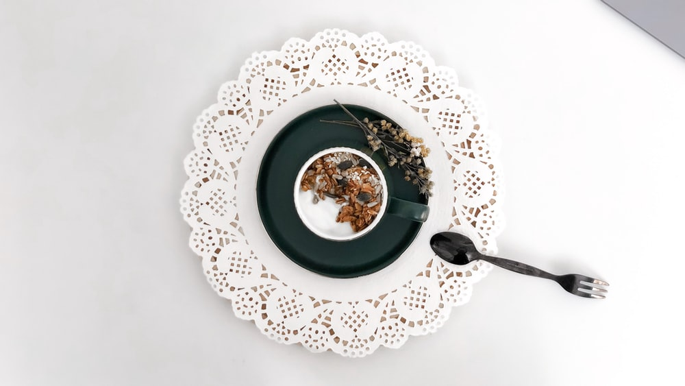 white and blue floral ceramic plate with soup