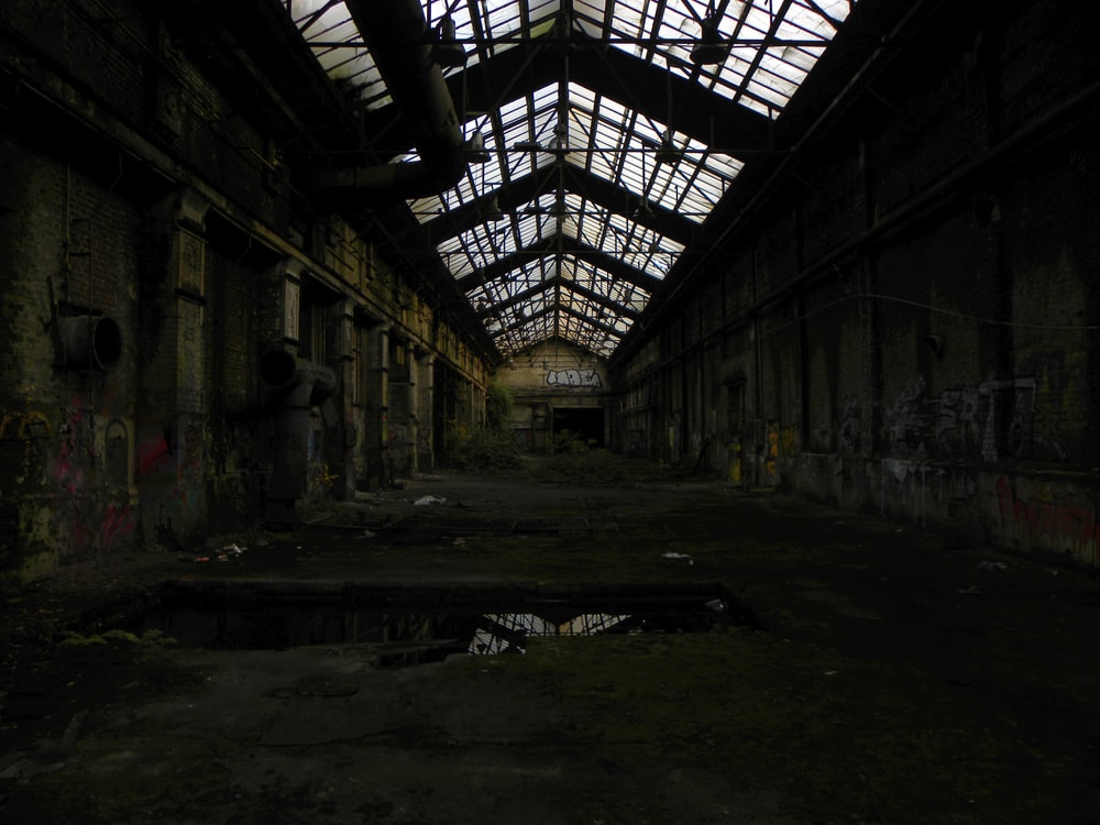 abandoned building with light turned on during daytime
