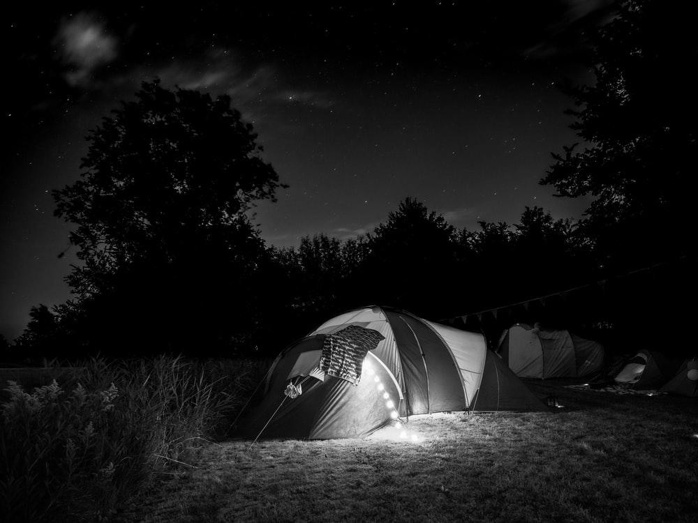 gray tent on green grass field during night time