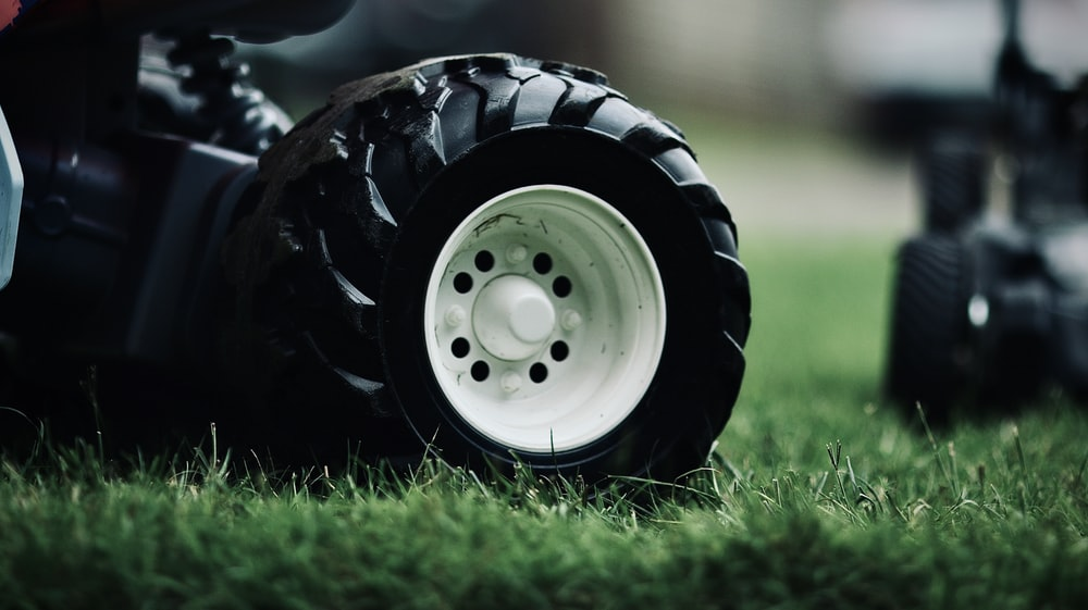 white and black wheel on green grass