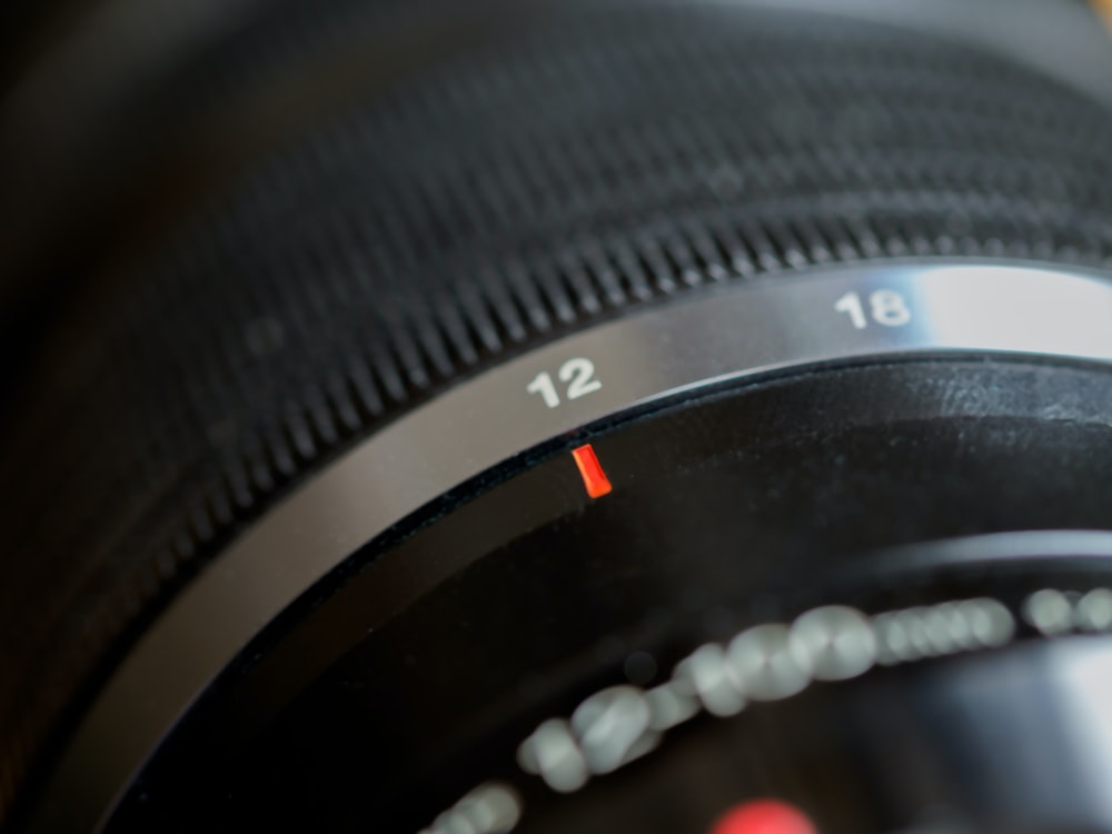 black camera lens with red light