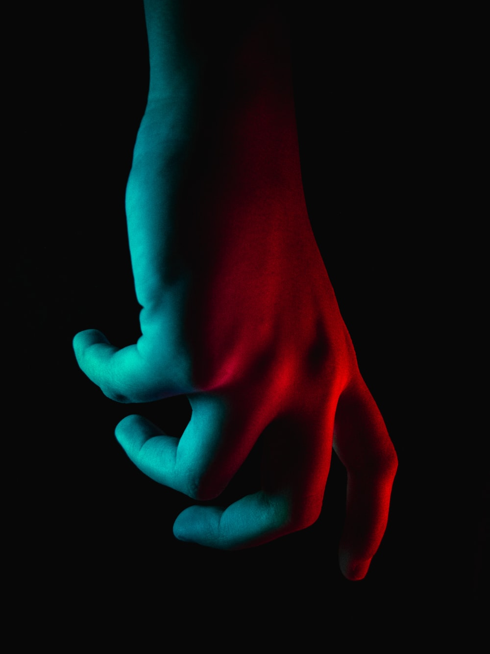 persons hand with red heart