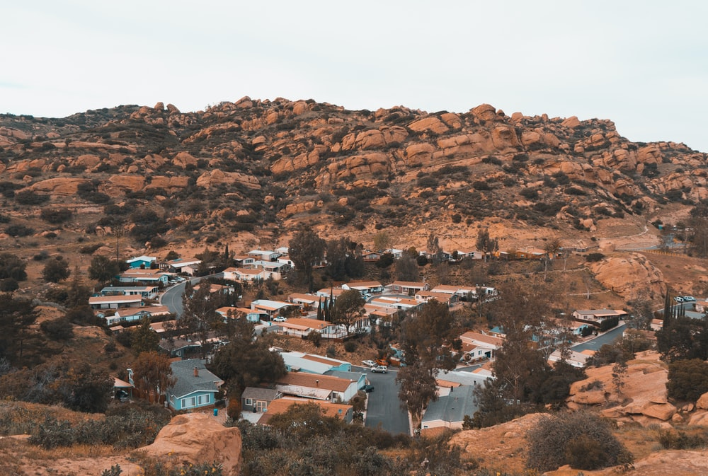houses on brown mountain during daytime