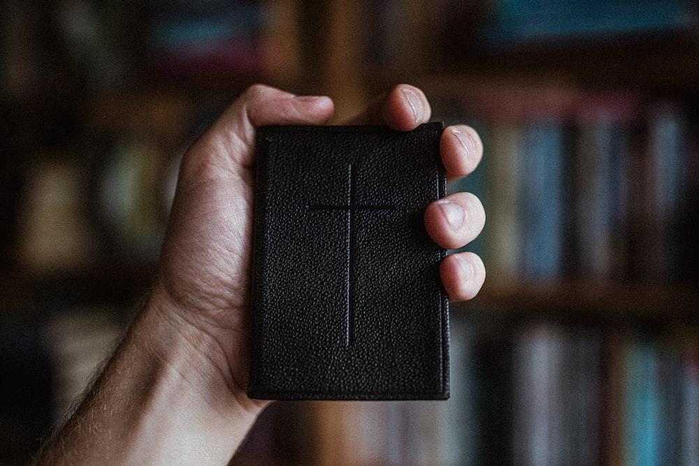 person holding black plastic case