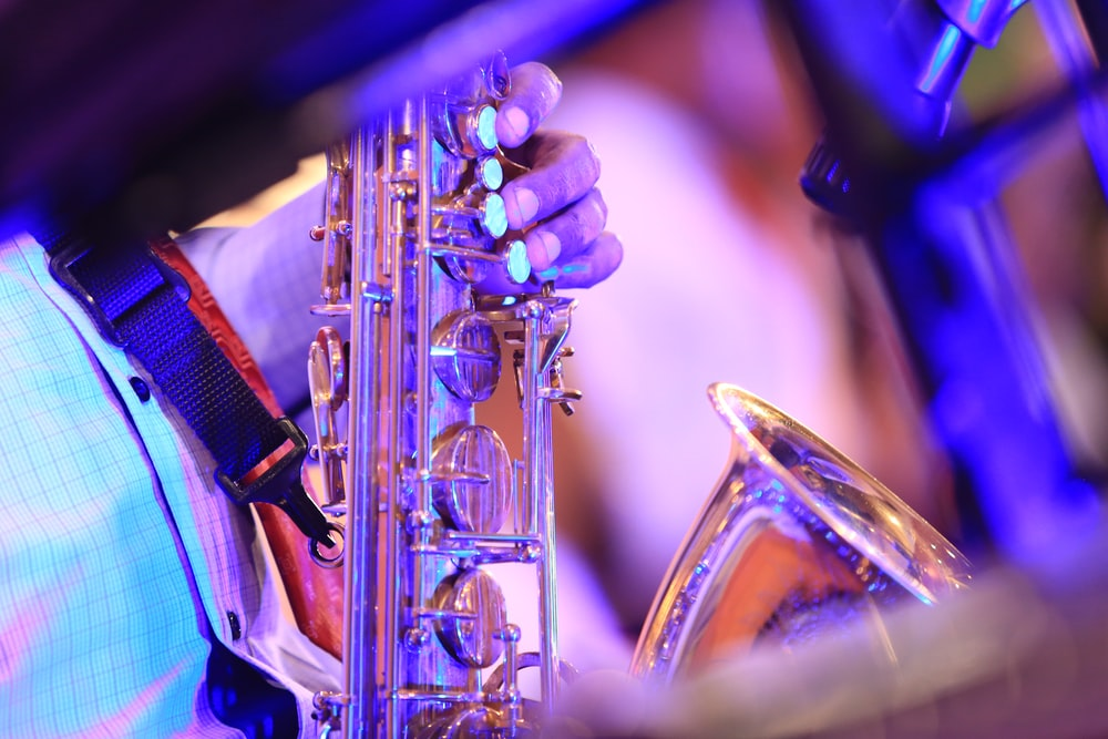 brass saxophone in close up photography